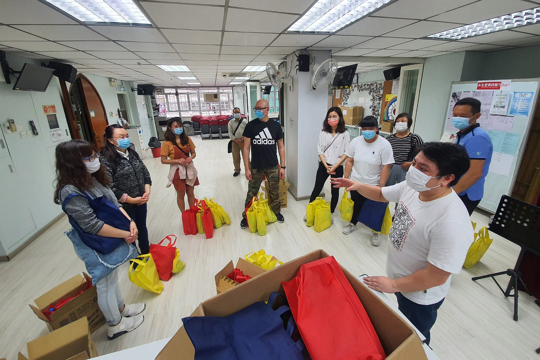 Volunteers at the Eternal Life Lutheran Church in Hong Kong prepare supplies to distribute to local people in need