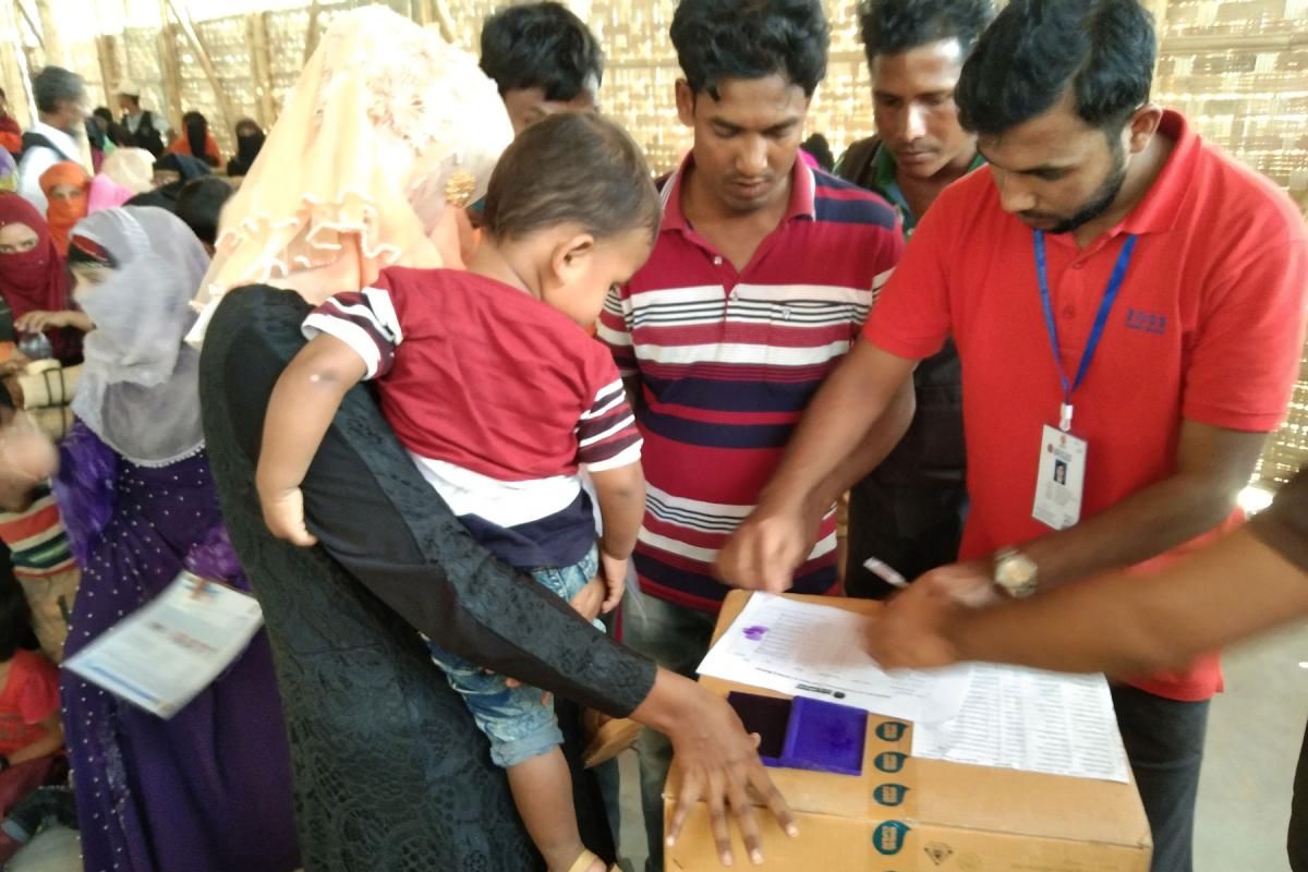 Rohingya refugees in Cox's Bazaar IDP camp receive a distribution of WASH kits by LWF's local partner. Photo: LWF/ B. Khanal