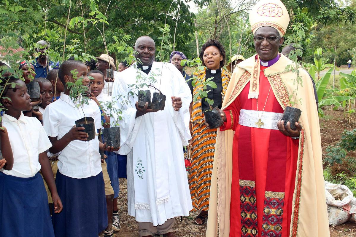 Planting trees has become part of church life in ELCT: (from the right) Bishop Fredrik Shoo, Rev. Faustine Kahwa, Rev. Solomon Massawe and students attending confirmation classes preparing for a tree planting in Tanzania's Northern Diocese. Photo: ELCT