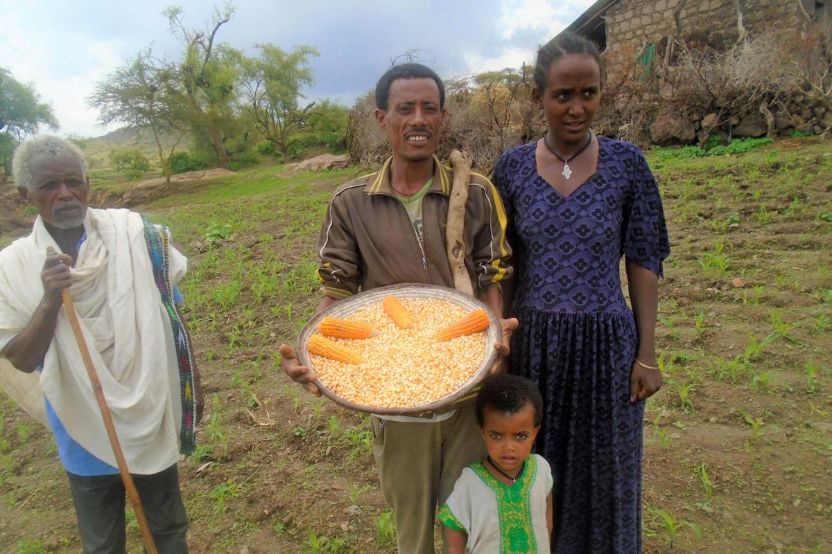 Amare Mulaw and his family, showing his 'Lutheran' corn. Photo: LWF/ Yitbarek FREW
