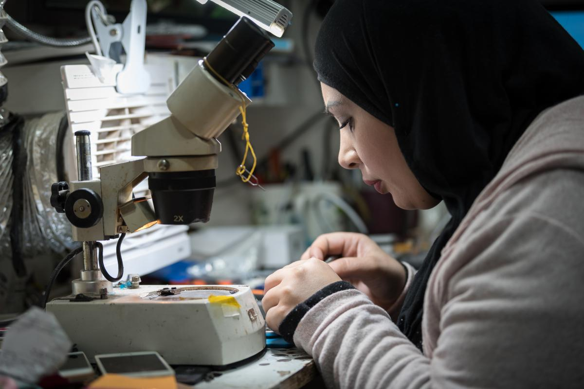 29-year-old Jihad Albaba, from the Am'ari Camp, repairs the wifi functionality of a mobile phone in a small shop in Ramallah, after graduating from studies in Telecommunication at the LWF vocational training center in Ramallah. The GRIT project aims to increase the number of Palestinian women in technical and other non-traditional professions, which often offer better paid jobs. Photo: LWF/Albin Hillert